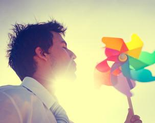 Businessman Blowing Wind Summer Power Energy Concept