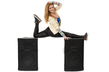 female dancer doing the splits on two speakers