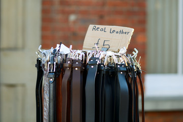 Leather belts for sale at market stall