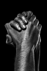Strong male hands in black paint on black background