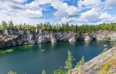 Flooded marble quarry. Visible gallery.