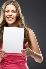 young woman smile, show thumb up, holding white blank board.