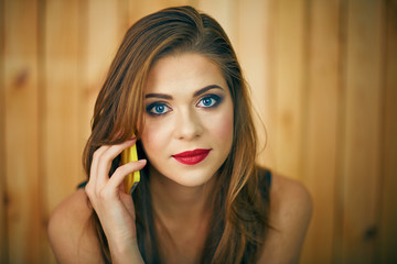 miling woman talkin phone. Beautiful girl face portrait with ev