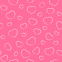 Drawing Valentines hearts on pink