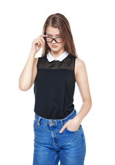 Young fashion girl in jeans and glasses posing isolated