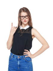 Young fashion girl in jeans with horn gesture isolated