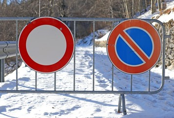 signs of the road closed for the abundant snowfall