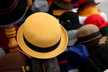 felt hat for sale in clothes store