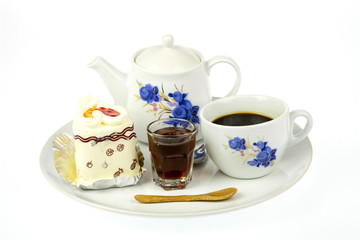 cup of coffee and delicious cake
