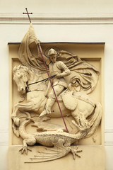 Saint George killing Dragon. Stucco decoration on Art Nouveau bu