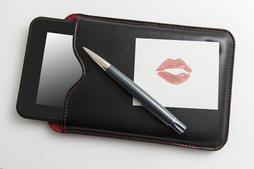 Tablet with pen and love memo