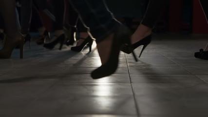 Many women heels are on the podium