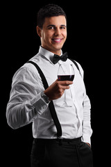 Elegant guy holding a glass of red wine