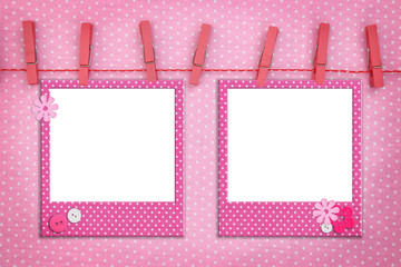 Pink photo frames hanging on a rope