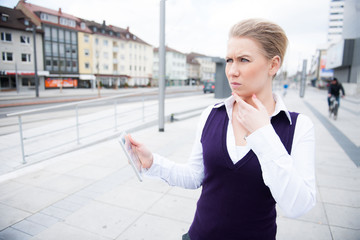 young business woman with tablet is confused