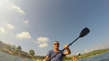 Happy men kayaking wide shoot