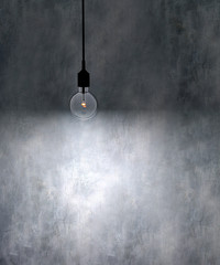 Old grunge wall with bulb light