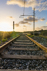 Railway at sunset. Low angle view