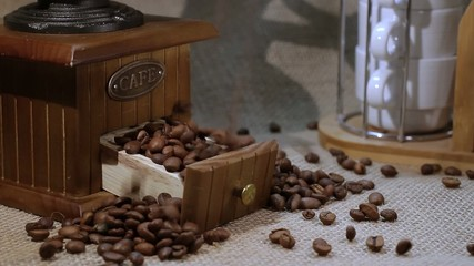 roasted coffee beans  falling down in coffee grinder