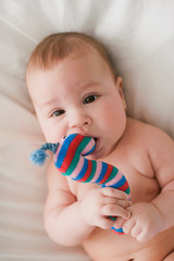 baby with a toy