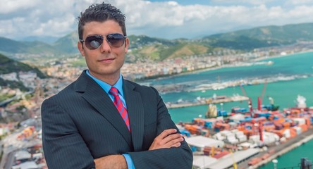 Handsome Young Successful Business Man Looking At Port Shipping