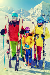 Ski - family enjoying winter vacation, filtered