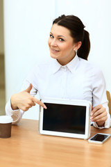 Happy young businesswoman using tablet