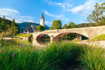 Church of Sv. John the Baptist and a bridge by the Bohinj lake