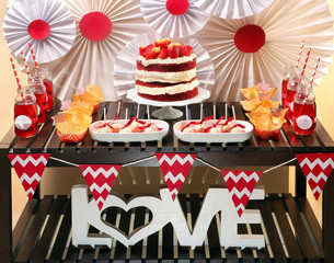 Valentine's Day party table with red velvet cake