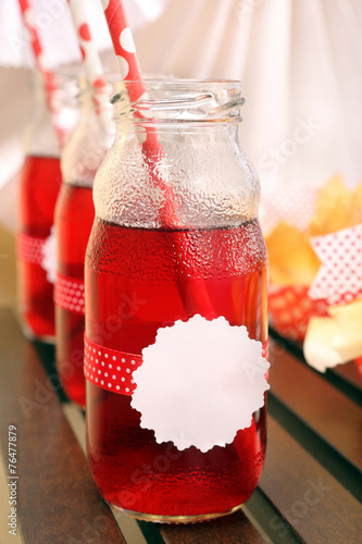 Cranberry juice in bottles for a party - 76477879