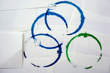 blue and green ring stain on white paper background
