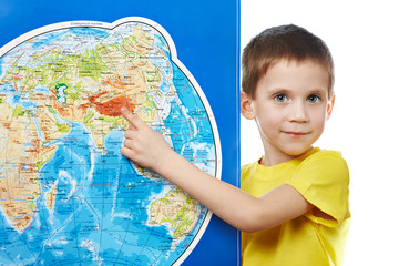 Little boy points to place on world map.