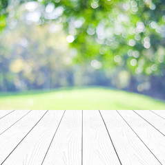 Empty perspective white wood over blurred trees background