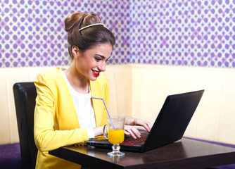 Beautiful modern young woman sitting at the laptop