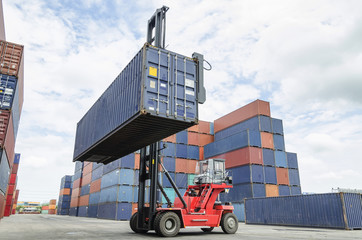 Crane lifter handling container box loading to truck in import e