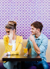 Cute young couple sitting at the table