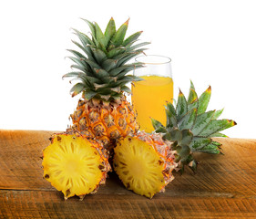 pineapple and juice isolated on wood texture