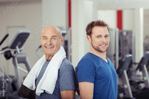canvas print picture zwei männer im fitness-studio