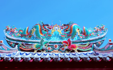 beautiful dragon statue decorated on chinese temple roof against