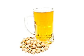 mug of beer and tasty pistachios closeup