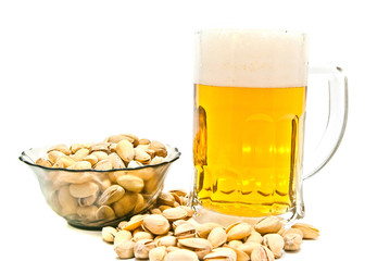 pistachios and glass of beer