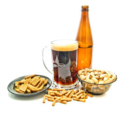 different snacks and beer in glass