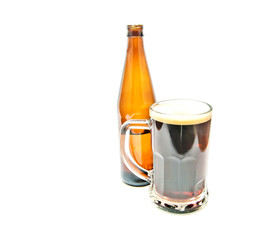 mug of dark beer and bottle