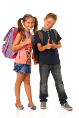 choolboy and schoolgirl with schoolbags isolated over white back