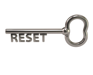 Silver key with word reset