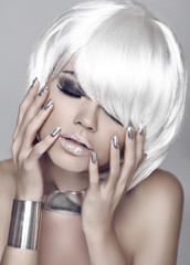 Fashion girl. Blond bob hairstyle. Eye makeup closeup. Beautiful