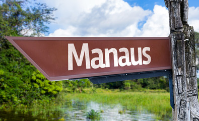 Manaus wooden sign with a forest background
