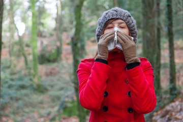 Young woman suffering from a cold or flu