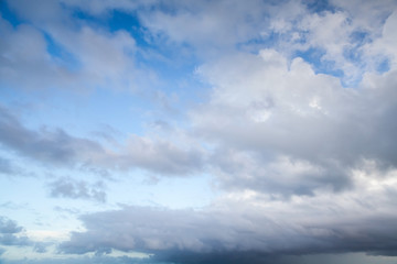 Blue sky with dark stormy clouds, nature background