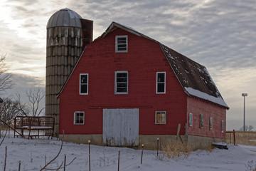 Striking Red Barn and Silo at Dusk